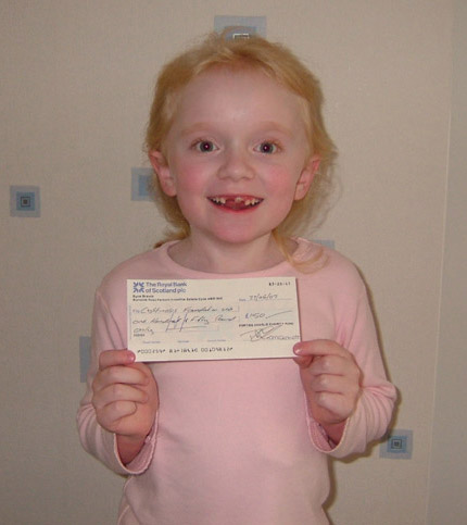 Lena holding the cheque