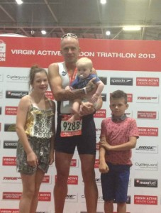 Matthew with his family, after completing the London Triathlon