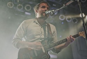 Scott Hutchison performing with guitar