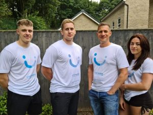 Four people wearing white Cystinosis Foundation UK t-shirts.